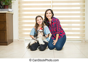 Cute family relaxing at home