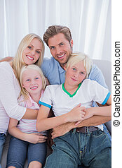 Cute family sitting on couch