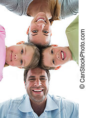 Cute family smiling down at camera together