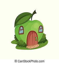 Cute fantasy house in form of ripe apple surrounded by green...