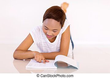 female african college student studying at home