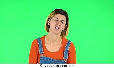 Cute female feels very bad, her stomach hurts . Green screen