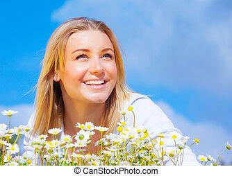 Cute female on daisy meadow