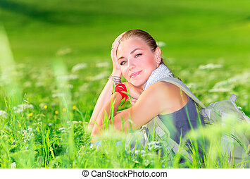 Cute female on floral field