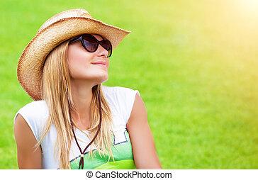 Cute female on green field