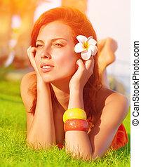 Cute female on green grass