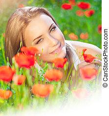 Cute female on poppy field