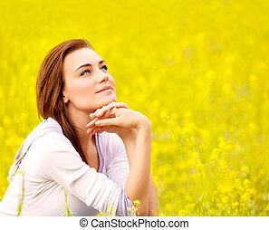 Cute female on yellow floral field - Closeup portrait of ...