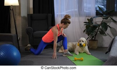 Cute female stretching legs with dog - Obedient labrador...