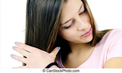 Cute female teenager brushing long hair slow motion isolated...
