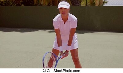 Cute female tennis player side view - Side view on cute...