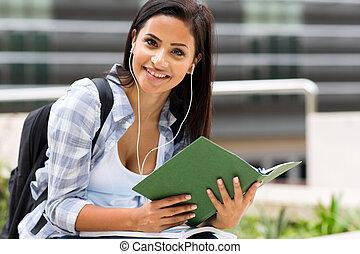 female university student listening music