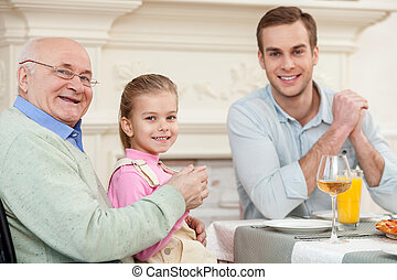 Cute friendly family is dining together - Portrait of...