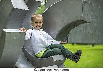 little boy sitting on the Playgroun