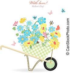 cute garden wheelbarrow with wild flowers with love. mother's da