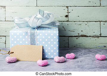 Cute gift box and blank brown paper tag with pink heart