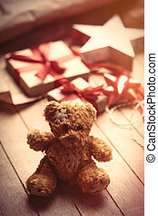 cute gift, star shaped toy, teddy bear and things for wrapping on the wonderful wooden brown background