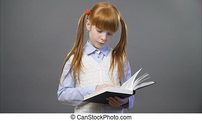 Cute ginger girl is reading the book