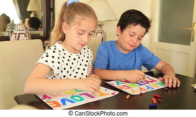 Cute girl and boy drawing