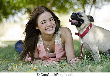 Cute girl and her dog having fun