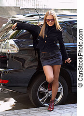 cute girl and luxury car