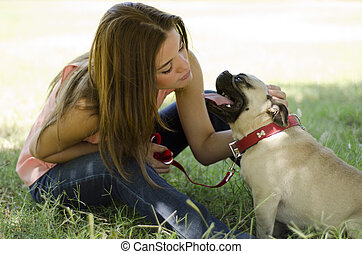 Cute girl at a park with her dog