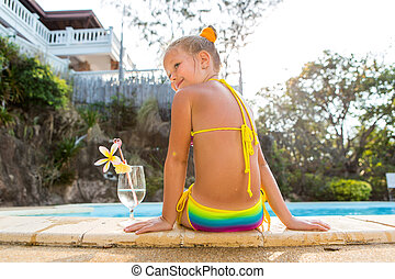 Cute girl at the pool