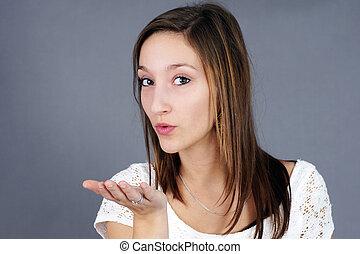 Cute girl blowing a kiss