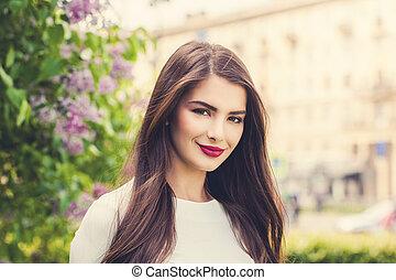 Cute girl brunette outdoor in summer sunny day