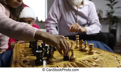 Cute girl capturing white pawn in chess game - Cute little...