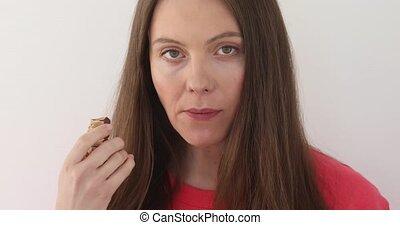 Cute girl chewing chocolate - Girl bites slice chocolate...