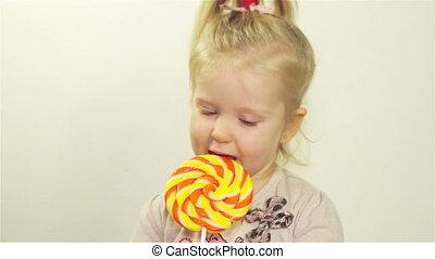 Cute girl chews candy