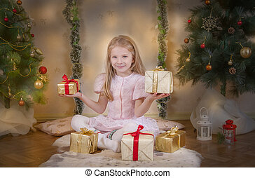 Cute girl choosing best gifts at Christmas