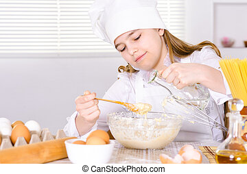 Cute girl cooking  in the kitchen