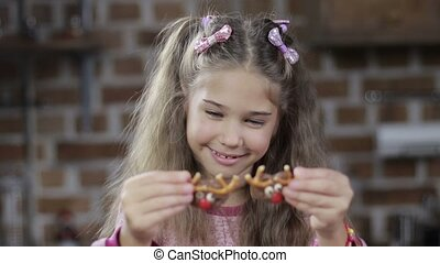 Cute girl covering eyes with homemade cookies - Adorable...