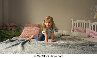 Cute girl crawling on bed - Adorable girl crawling on...