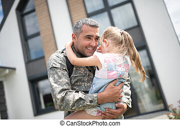 Cute girl crying after seeing her father returning home