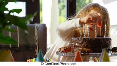 Cute girl decorating cake at home 4k - Cute girl decorating ...