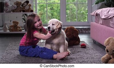 Cute girl doing morning exercises with puppy - Adorable...