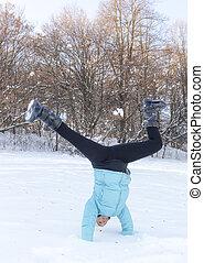 Cute girl doing the cartwheel