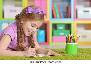 Cute girl drawing at home