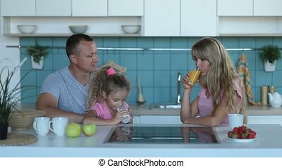 Cute girl drinking milk in kitchen in the morning