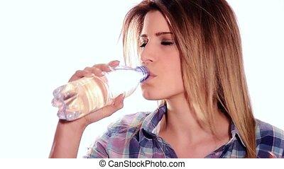 cute girl drinking water from bottl