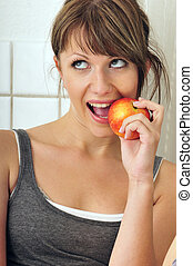 cute girl eating a red apple
