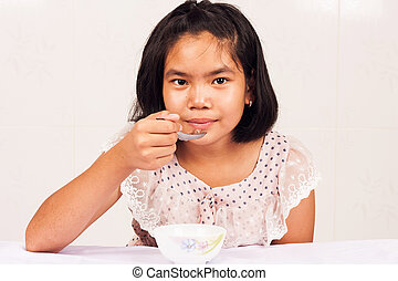 Girl Eating Cereal Clipart