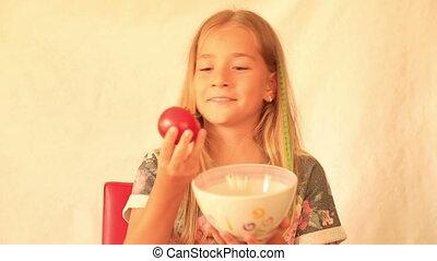 Cute girl eating tomatoes