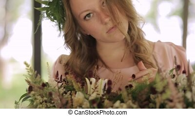Cute girl enjoys smell flowers - Beautiful girl with wreath...