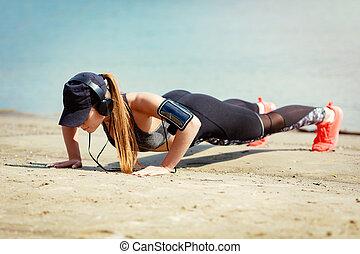 Cute Girl Exercising On The Beach