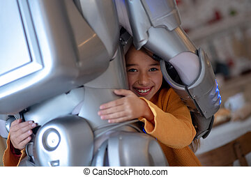 Cute girl feeling protected with her robot