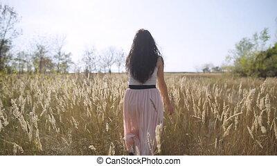 Cute girl flees field slow motion - Cute girl flees field...